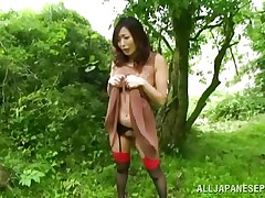 Nature loving Nippon cutie is receiving her dose of wilderness! This cute bitch has her hands bound on a tree branch and gets roughly fucked from behind. Her moans and screams won't help her because there's nobody around. Look at that sweet snatch being rubbed with a vibrator and then drilled hard.